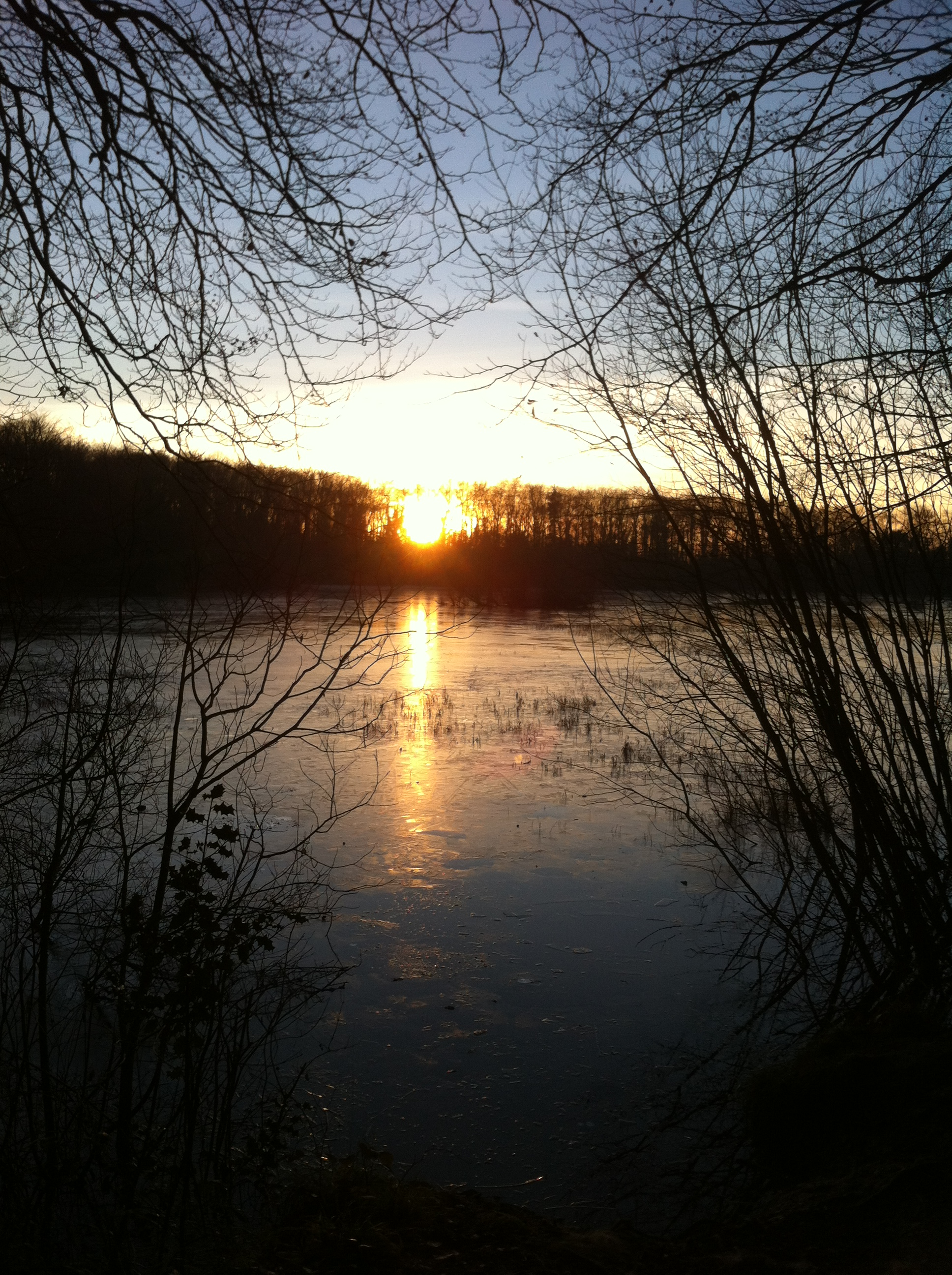 Sunset, frozen lake